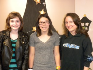 Poetry slam winner Alianora Reilly, left, with second-place winner Kate-Lynn Walsh, center, and the third-place finisher, Julia Rose Gottier.