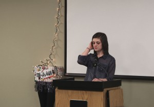 Second-place finisher Ariel Nadeau performs her poem